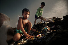 Steung Meanchey,Cambodia - Chai and Tira worked the garbage dump (Mio Cade) Tags: poverty boy shirtless sun hot glass shirt site kid dangerous garbage cambodia child risk treasure cut poor environmental dump social sandal chai phnom scavenger penh tira barefooted steung meanchey