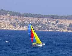 Hobie Cat (albireo 2006) Tags: blue sea cliff yellow bay mediterranean sailing wind malta explore sail mellieha ghadira kiteboading