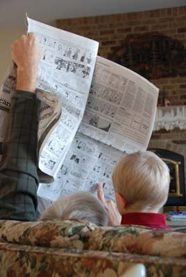 reading the funnies with grandpa