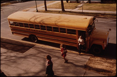 Students Arriving by Schoolbus at Cathedral Senior High School in New Ulm, Minnesota...