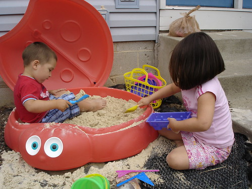 Corinne and Mason in the sand
