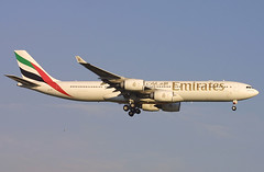 Emirates Airbus A340 (A340-500) A6-ERJ, arriving JFK, New York, USA. Sept 2007 (Tom Turner - SeaTeamImages / AirTeamImages) Tags: city nyc usa newyork plane airplane fly airport unitedstates aircraft aviation transport flight jet gear quad spot jfk passengers emirates queens international anchorage final transportation airline airbus pax passenger airways airlines airbusa340 bigapple kennedy carrier mounds spotting airliner jetplane a340 johnfkennedy portauthority fuselage tomturner a340500 a6erj