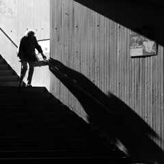 Conscious steps (skubmic) Tags: old light shadow blackandwhite bw woman concentration moving stair walk steps careful aware conscious skubmic