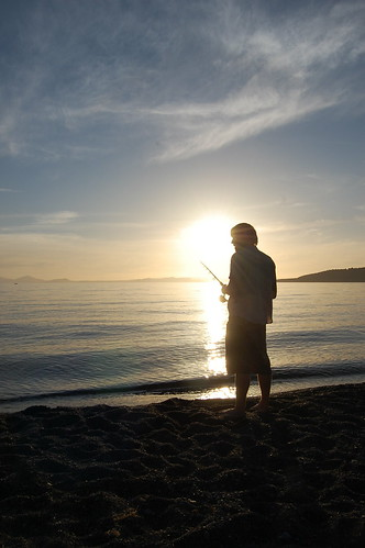 Tony fishing for trout at Lake Taupo