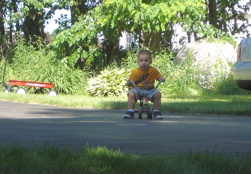 Mason riding his little bike