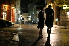 Walking with our thoughts (Aeioux) Tags: road city two woman man topf25 car silhouette topv111 night walking 50mm topf50 topv555 topv333 couple 500v20f sofia streetlights pavement topv1111 topv999 fv5 bulgaria 500v50f 50100fav fv10 topv777 f18 200viewswinner