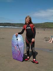 Maya In Wetsuit (Kaptain Kobold) Tags: holiday beach wales pembroke seaside sand maya shore wetsuit 2007 bodyboard whitesandsbay kaptainkobold