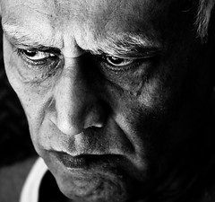 Intensity ... (knowsnotmuch) Tags: portrait sunshine intense eyes dad stare 80 explored 105vr
