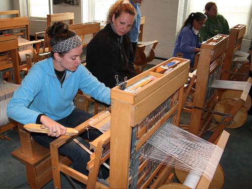 Teachers weaving on the hand loom
