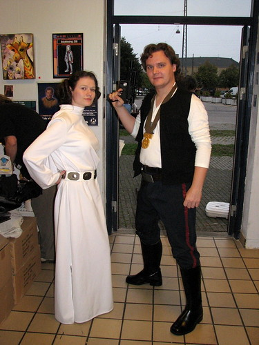 Pricess Leia and Han Solo posing for a picture