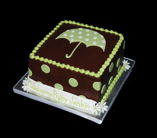sage green polka dot umbrella baby shower cake