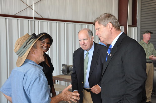 Secretary Vilsack and Congressman Spratt listen to the concerns of a dairy farmer at the Galloway Farm in Darlington, South Carolina