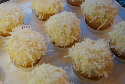 vanilla cupcakes with coconut cream cheese frosting