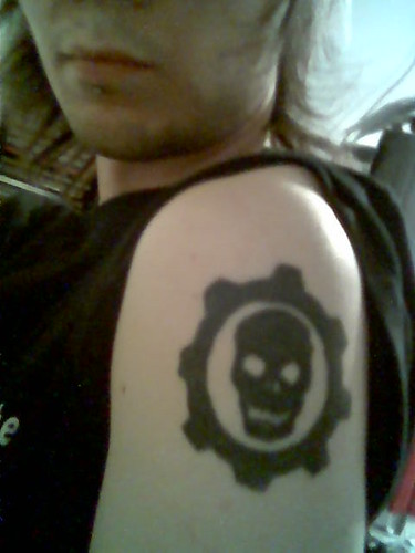 Then I got my Gears of War COG tattoo the day before I got my labret pierced