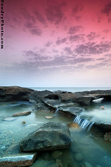 Sea Waterfall (A.alFoudry) Tags: ocean pink sea sky cloud seascape motion fall beach water rock clouds speed sunrise canon eos high rocks slow gulf falls full filter arab shore frame slowshutter shutter 5d kuwait usm arabian fullframe 2008 effect ef 1740mm canonef1740mmf4lusm kuwaiti arabiangulf q8 cokinfilter newday abdullah  cokin  f4l canoneos5d  kuw q80 xnuzha alfoudry  abdullahalfoudry  foudryphotocom