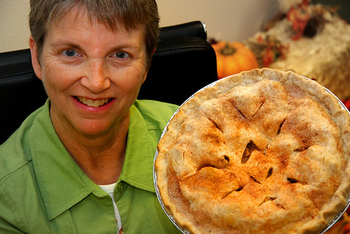 Last Chance Café manager Peggy Tobin shows off a homemade apple pie baked by a volunteer co-op member.