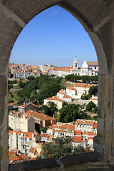 Arched view over Lisbon, Portugal. (mikel.hendriks) Tags: holiday castle portugal church window geotagged vakantie photo arch foto view lisboa lisbon sunny tourist explore photograph igreja lissabon uitzicht cloudless capture kerk breathtaking raam boog kasteel cityview castelodesojorge venster saojorge toeristen stadsgezicht graca canoneos50d castleofsojorge igrejadagraa ilustrarportugal archedview breathtakinggoldaward breathtakinghalloffame sigma1770mmf284dcmacrooshsm churchofgraa bebogen kasteelsintjoris kerkvangratie