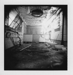 Prison bathroom 1 (Otto K.) Tags: atlanta bw abandoned film window polaroid bathroom shower blackwhite holga debris toilet center prison jail holgaroid urinal deserted decayed ue ubex pretrial detention type87 ottok