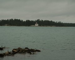 Shoal Island (Matthews Island) Lighthouse in the rain (wintorbos) Tags: lighthouse rain greatlakes lakehuron algoma pineisland shoalisland matthewsisland stjosephchannel