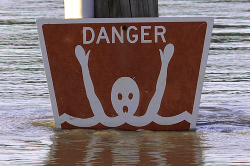 "Sign - ""Danger No Swimming"", at riverfront, in Washington, Missouri, USA"