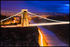 Bristol - Clifton Suspension Bridge and Avon Gorge (Yen Baet) Tags: uk longexposure greatbritain bridge sunset england mountain architecture bristol twilight europe cityscape view unitedkingdom britain dusk scenic somerset landmark icon tourist observatory vista gorge british lighttrails bluehour iconic suspensionbridge clifton giantscave avonriver isambardkingdombrunel leighwoods europeancities bristolinternationalballoonfiesta