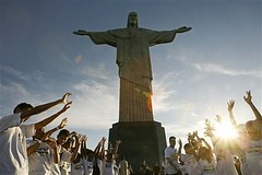 Children rise their hands as they attend a ceremony to promote and support the candidature of the Christ the Redeemer statue to the New Seven Wonders of the World in Rio de Janeiro in this Wednesday, May 2, 2007 file photo.  Christ the Redeemer was select