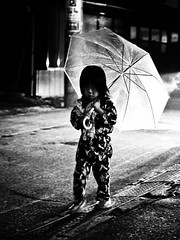 Little girl with an umbrella in the rain (manganite) Tags: street girls portrait people bw cute topf25 rain fashion festival japan kids night contrast digital umbrella children geotagged asian japanese interestingness topf50 nikon topf75 bravo asia mood child nightshot tl candid traditional young atmosphere streetscene july23 explore yukata  nippon d200 nikkor dslr topf150 topf100 vignette matsuri nihon kanto tsuchiura ibaraki japanesegirl 50mmf18 fav100 interestingness120 i500 flickrsbest utatafeature manganite nikonstunninggallery ipernity july232006 tsuchiuramatsuri vision1000 visiongroup geo:lat=36080013 geo:lon=140204446 date:year=2006 vision100 date:month=july vision10000 format:ratio=43