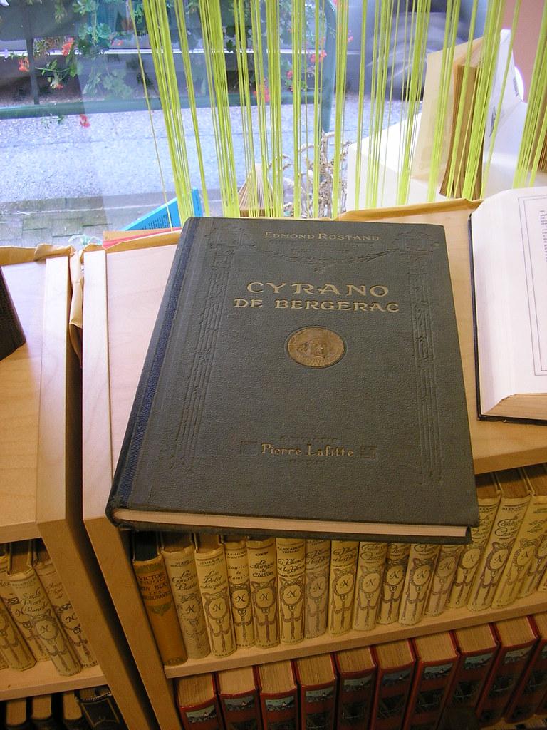 Cyrano de Bergerac by Edmond Rostand book on rack.