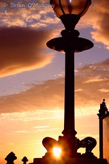 Morning Pawn (Brian O'Mahony) Tags: beach lamp beautiful wales sunrise earlymorning seafront llandudno latern pawn damncool northwales fluffyclouds artistoftheyear brianomahony platinumheartawards sunthroughthehole whenthesunrisesitsbeautiful life~asiseeit thephotographiceye