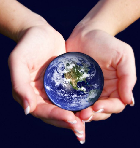 An image of the earth from space being held in someone's hands