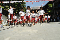 IDN-Jakarta-0608-79-v1 (anthonyasael) Tags: school girls boy boys students colors girl smile childhood smiling horizontal scarf children indonesia asian fun happy person togetherness java jumping movement education friend uniform asia exterior child veil view friendship arm mr flag muslim islam religion headscarf joy hijab tie happiness running excited run front flags full together jakarta covered enjoy only cropped schoolchildren cheerful schoolgirl excitement length schoolgirls enjoying excite enjoyment pupil exciting raised ethnicity schoolboy believer schoolchild cheerfulness tchador
