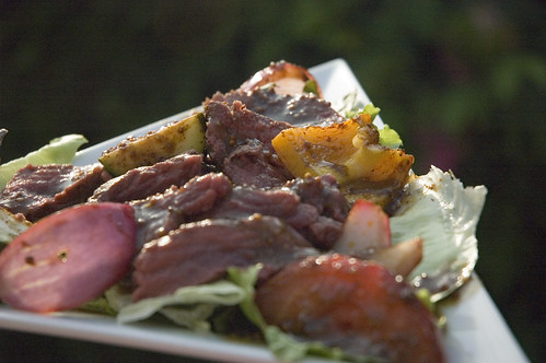 grilled elk salad with curry glazed vegetables and maple balsamic dressing