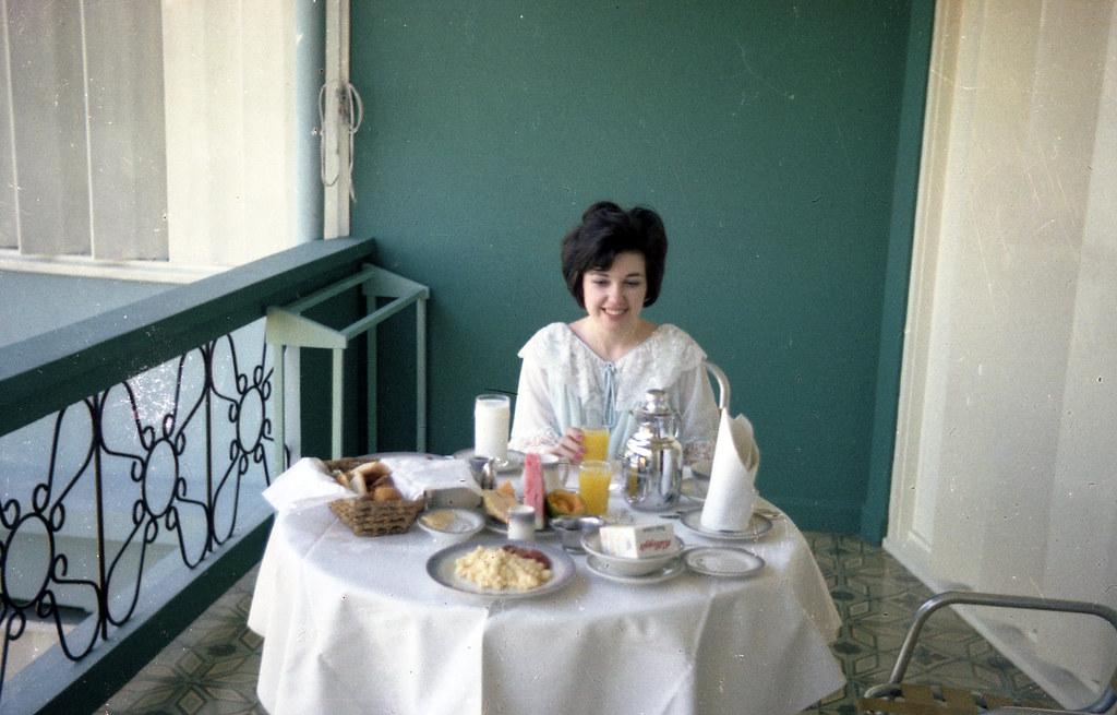Mom eating breakfast on her honeymoon
