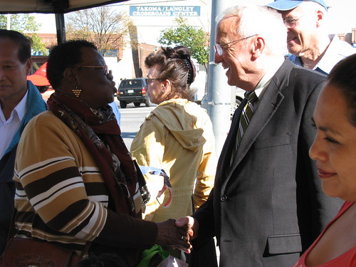 USDA Under Secretary Kevin Concannon meets Susan Leitch, a regular shopper at the Crossroads Farmers' Market in Tacoma Park, Maryland, Wednesday October 13.