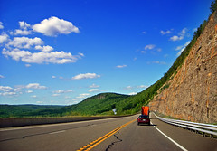 Cliff-Hanger (Nicholas_T) Tags: road summer sky clouds rural driving pennsylvania brightlight cumulus creativecommons endlessmountains route6 usroute6 bradfordcounty