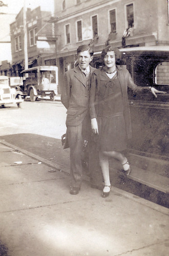 A young couple and a car