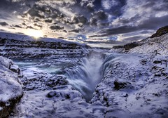 The Waterfall Crevice (Stuck in Customs) Tags: pictures lighting winter light panorama white snow cold art texture ice water lines modern clouds composition work reflections river painting photography waterfall iceland intense nikon perfect exposure shoot artist mood photographer shot angle photos unique background details d2x perspective images best glacier covered edge processing pro slip framing icy capture tones gulfoss gullfoss slippery hdr treatment mostviewed icefall highquality stuckincustoms treyratcliff