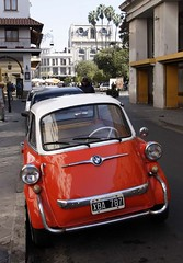 Romi Isetta (micmol ) Tags: red white man argentina argentine car vertical america alone south small 4 wheels entrance plate nobody front iso latin bmw driver hispanic economy romi compact salta isetta 787 sinlge xba