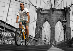Bicycle Race (noamgalai) Tags: nyc bridge white ny newyork black bike bicycle yellow brooklyn race photography photo driving picture july photograph wires brooklynbridge noam bicyclerace allrightsreserved 2007   photomania  noamg galai yellowbicycle noamgalai   wwwnoamgalaicom sitelandscapes