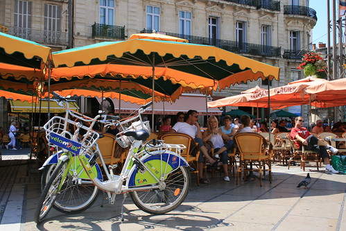 Vélomagg bikes from the local public cycle hire scheme take a breather outside a Montpellier café. Photo: Jean-Louis Zimmermann