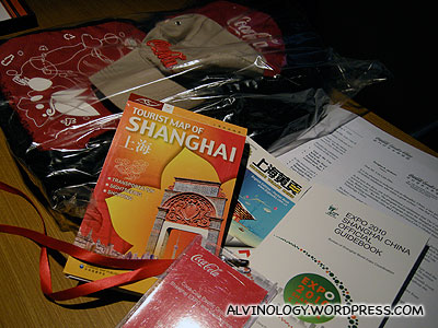 Welcome gifts from Coca-Cola - a bag made of recycled bottles; Shanghai map; Expo guide; Shanghai phone directory; a cap; among many other items