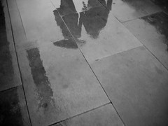 01370043 (twistinbendavies) Tags: street city shadow urban bw white motion black reflection building london lines rain by umbrella walking holding hands couple afternoon pavement sony romance lovers relationship walkway romantic passerby dsc