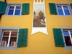 banner (overthemoon) Tags: windows green yellow reflections switzerland banner medieval shutters middleages moyenge romandie johnhowe genevalunch saintursanne memoriesofmiddleearth