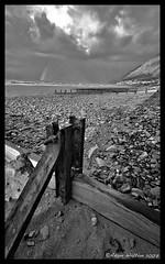 beachatllanfairfechan02.jpg (Adam Walton) Tags: blackandwhite storm beach monochrome clouds mono seaside overcast pebble groyne conwy seadefence northwales llanfairfechan a55