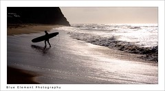 Silhouette of a surfer (~* Rae Rae *~) Tags: ocean morning copyright beach silhouette newcastle sand waves surfer australia nsw surfboard glimmer shimmer longboarder barbeach raethrenoworthphotography blueelementphotography raethrenoworth blueelement