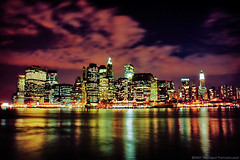 Manhattan at Night (jpnuwat) Tags: city nyc longexposure trip urban usa cloud newyork reflection skyline night river manhattan 2006 fultonlanding dsc8572b