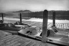 Mirror Lake Paddleboats at Dawn (HDR 5xp) (Gregory Pleau) Tags: morning blackandwhite mist mountain lake newyork water dawn mirror boat dock paddle hdr 5am lakeplacid 5xp ©gregorypleau