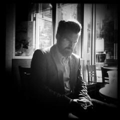 Mr. Melancholy (antonkawasaki) Tags: portrait blackandwhite bw candid starbucks squareformat camerabag lookingsad 500x500 handsomegentleman wearingsuit antonkawasaki iphone3gs mrmelancholy bigbeardedmale mobilephotogroup
