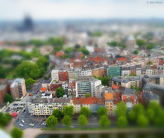 Miniature - 3 (Ben Heine) Tags: road park street camera city trees houses light wallpaper urban panorama orange inspiration blur green art cars colors field architecture clouds composition contrast photoshop buildings germany landscape photography town miniature scary scenery play lego earth lumire maisons air small fake cologne blurred mini kln simulation scene oxygen arbres illusion terre series conceptual breathe paysage rues ville flou petit ecosystem selectivefocus luminosity postprocessing colorsaturation theartistery tiltshiftphotography scheimpflugprinciple benheine samsungimaging nx10