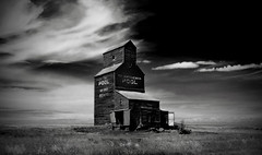 the forgotten prairie giant (danielle marie photography) Tags: blackandwhite bw abandoned interestingness1 ghosttown saskatchewan 1022mm grainelevator bents